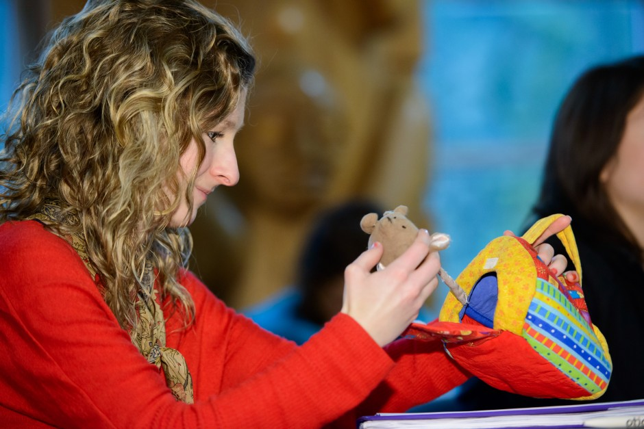 Gillian Taylor, a first-year audiology student, gets an up-close glimpse of Moe the Mouse.