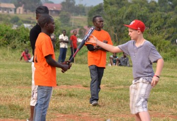 A member of the Ugandan team exchanges tips with his counterpart from Langley.