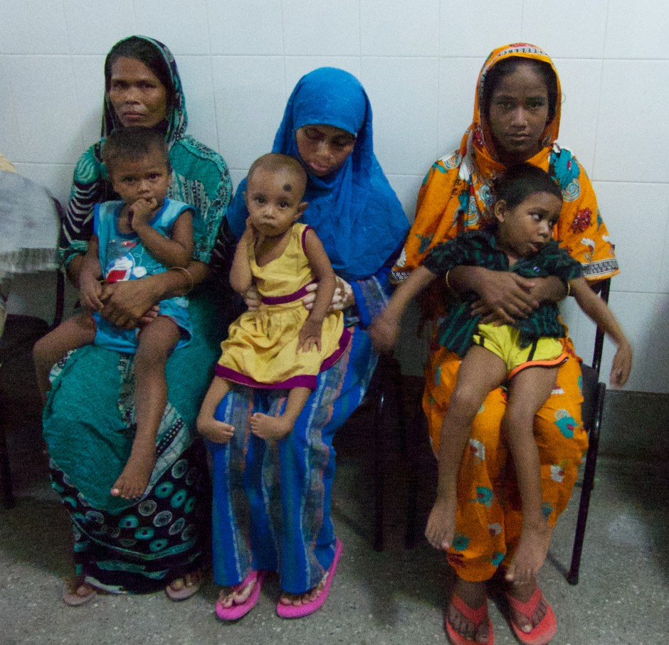 Children with foot deformities wait with with their mothers to be assessed at one of Dr. Pirani's training session in Dhaka. Photo: Lynn Staheli