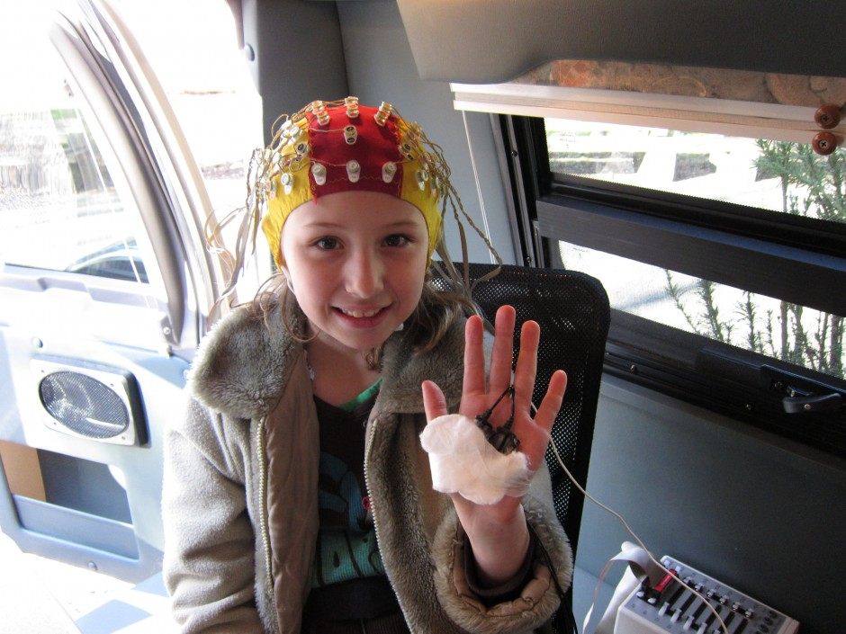 A girl in a specially-equipped van has her brain's electrical activity monitored, in a UBC study led by Michael Kobor. Photo: Human Early Learning Partnership