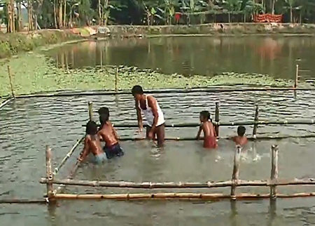 Bangladeshi children learning water survival skills.