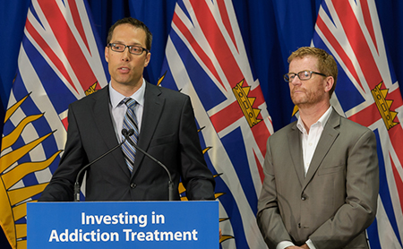 Evan Wood (left), accompanied by B.C. Health Minister Terry Lake, speaks at the announcement of provincial and U.S. funding for research and training in addiction medicine.
