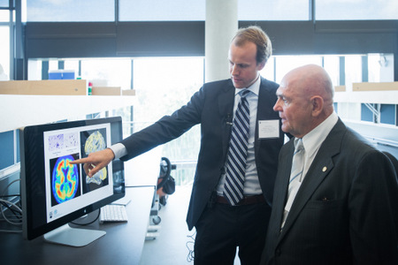 L-R: Haakon Nygaard, the Fipke Professor in Alzheimer's Research, in his lab, describes the biology of the neurodegenerative disease to donor Chuck Fipke. Photo credit: Martin Dee