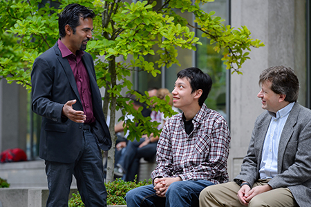 Allen Zhang (centre) speaks with his PhD co-supervisors, Sohrab Shah (left) and Wyeth Wasserman.