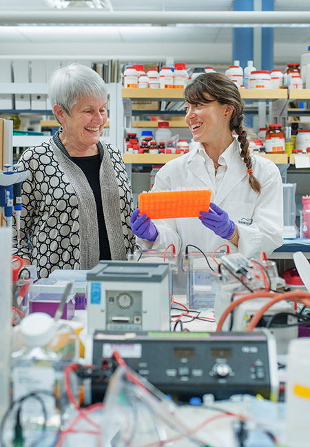 """L-R: Irene Bettinger and Judith """"Max"""" Silverman in Neil Cashman's lab. Photo by Martin Dee"""