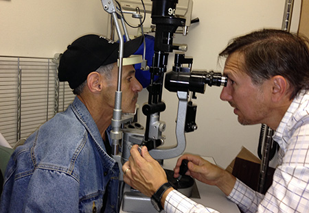 David Maberley, Head of the Department of Ophthalmology and Visual Science, examines a patient at the Downtown Eastside clinic.