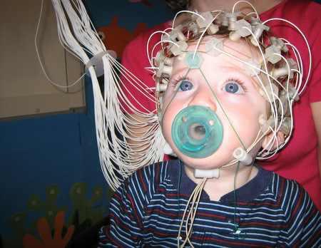 Measuring a child's electrical brain activity.