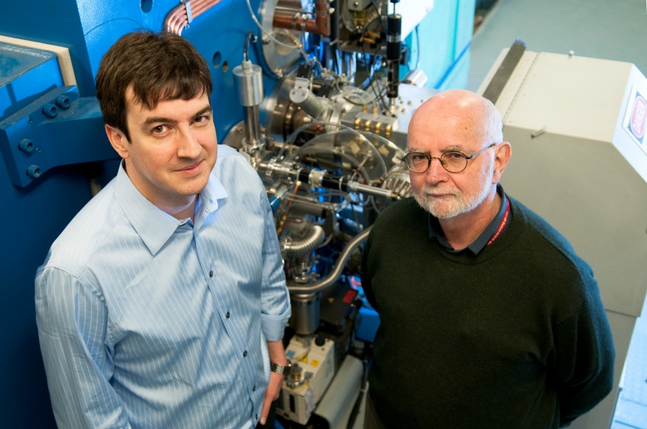 L-R: Francois Benard and Tom Ruth with the cyclotron at BC Cancer Agency. Photo credit: Martin Dee