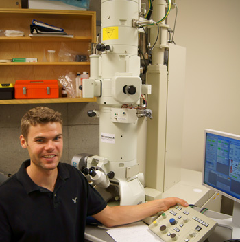 Ryan Heron spent the summer researching the effects of a nutritional supplement - omega-3 fatty acids - on the growth of neurites.
