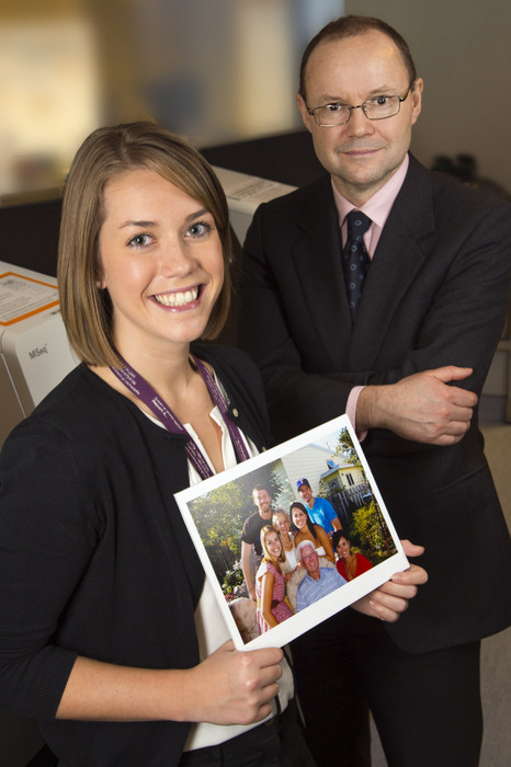 Samantha Hansford, holding a photo of her Newfoundland family, and David Huntsman. Photo courtesy of BC Cancer Agency