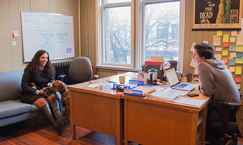 Dr. Skye Barbic seen speaking with a colleague about the Personal Recovery Outcome Measure.