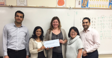 Hastings Elementary School Principal Janis Myers (centre) is presented with a cheque from UBC Cardiology residents, Drs. Sina Alipour (far left), Amelia Yip (second from the right) and Amit Khosla (far right), and residency program director, Dr. Parvathy Nair (second from the left).