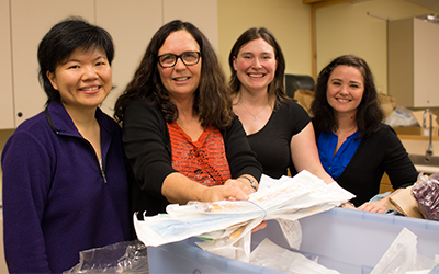 Cathy Ellis flanked by UBC Midwifery students Nancy Hsiao-Lan Tsao (far left), Jacquelyn Thorne and Rachelle Fulford (far right).