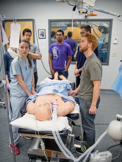 Residents dealing with a simulated trauma in the POEM course. Photo credit: Brian Kladko