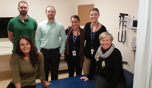 Dr. Cheryl Hume, Site Director for the UBC Kootenay Boundary Family Practice Residency and Dr. Willa Henry, Program Director, UBC Department of Family Practice, seated, celebrate the opening of new UBC space with Kootenay Boundary Family Practice residents Drs. Gabe Krahn, Mark Szynkaruk, Alana Benes, and Gretchen Snyman.