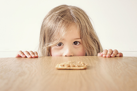Girl looking at peanut butter_post