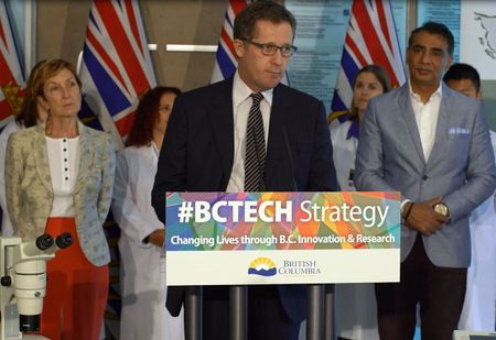 Bruce Verchere (centre) speaking at the funding announcement, flanked by Helen Burt, UBC's Vice-President, Research and International, and Amrik Virk, B.C. Minister of Technology, Innovation and Citizens' Services.