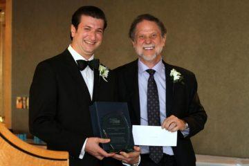 Dr Brandon Sheffield receives the Changemaker Resident Award.