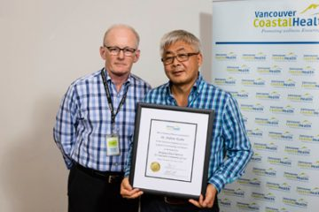 VA-Award-for-Bringing-Clinical-Renown-to-Vancouver-Hospital-—Dr.-Graydon-Meneilly-and-Dr.-Ken-Gin-accepting-on-behalf-of-Dr.-Andrew-Krahn