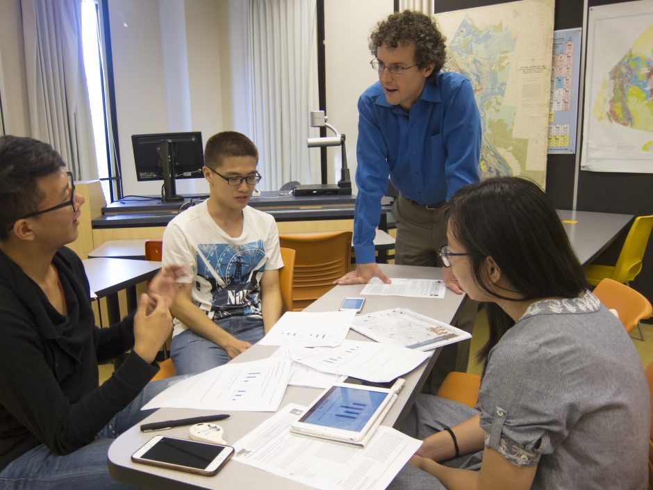 """Andrew Horne, an instructor in the Vancouver Summer Program in Medicine, facilitates a group discussion in his course, """"Pharmacology and Critical Analysis in Medicine and Science."""" Photo credit: Brian Kladko"""