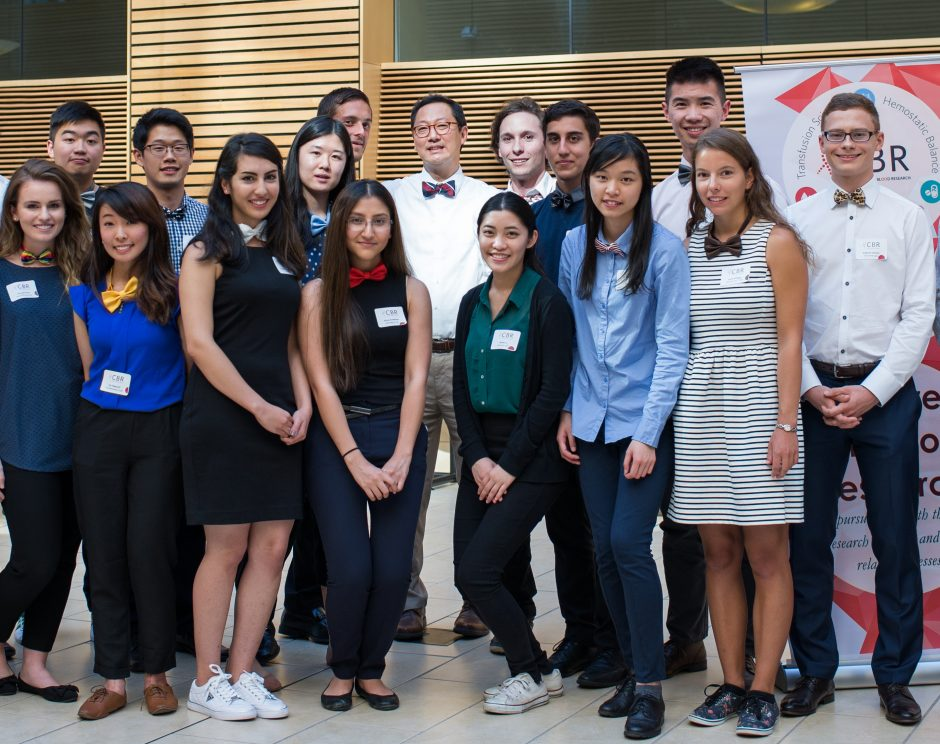 UBC President Santa Ono (in centre, with white shirt) surrounded by the Centre for Blood Research's summer students. Photo credit: Kitty Liu