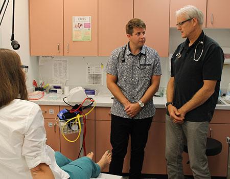 Travis Thompson (left) works alongside family physician Mark Lawrie in Penticton.