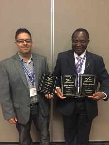 Folefac Aminkeng (right) receives The Canadian Society of Pharmacology and Therapeutics Boehringer Ingelheim Postdoctoral Award in Pharmacology and the Publication Award.