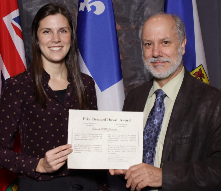 Elisabeth McClymont receiving the top student prize, with Shelley Deeks, Medical Director, Public Health Ontario & Chair, Vaccinology Student Research Program.
