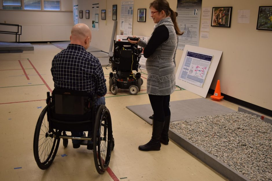 Emma Smith demonstrating the CoPILOT tool for motorized wheelchair training.