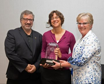 Dr. Rose Hatala receives the award.
