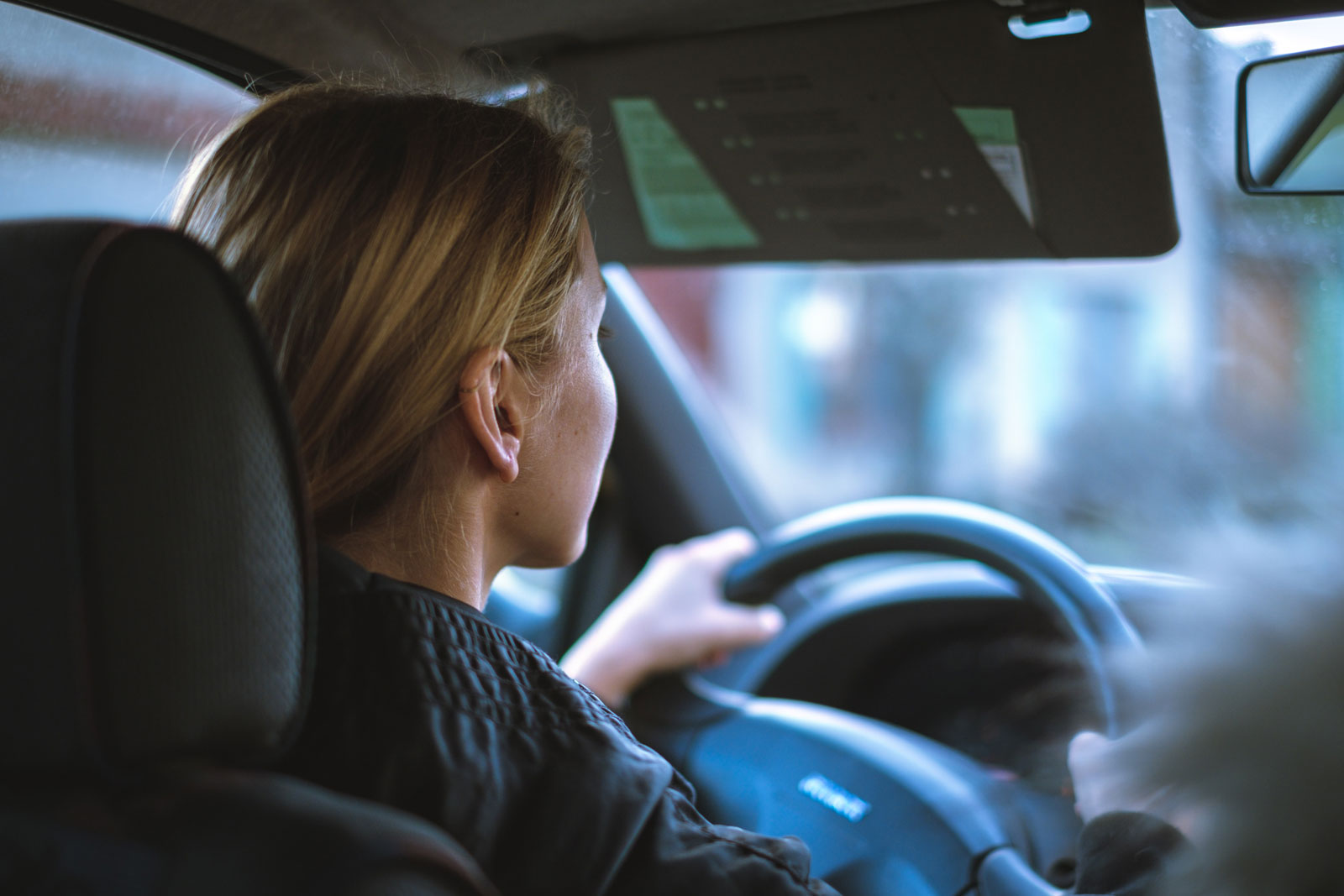 Woman driving a car and looking straight ahead